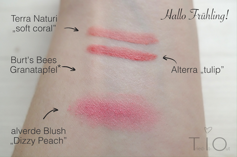 Swatches of soft coral by Terra Naturi, Tulip by Alterra, Pomegranate lip care from Burt's bees and Dizzy peach blush by alverde
